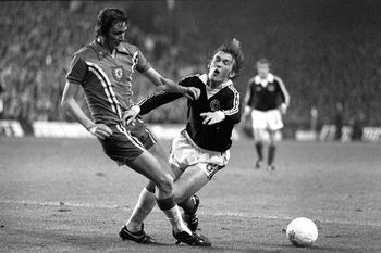 Wales' Rod Thomas moves in to challenge Scotland's Kenny Dalglish-1373146