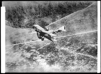 Downward_view_of_a__Chateau_Thierre_Aeroplane_,_a_World_War_I_aircraft,_in_flight_over_Argone_Forest_and_French_trenches,_ca_1914-1918_(CHS-11659)
